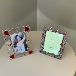 Two metal picture frames